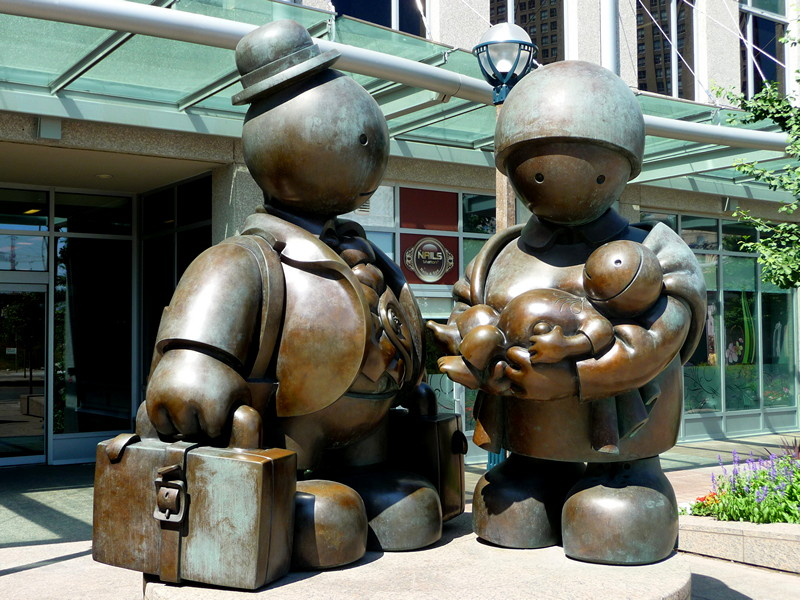 Immigrant family sculpture